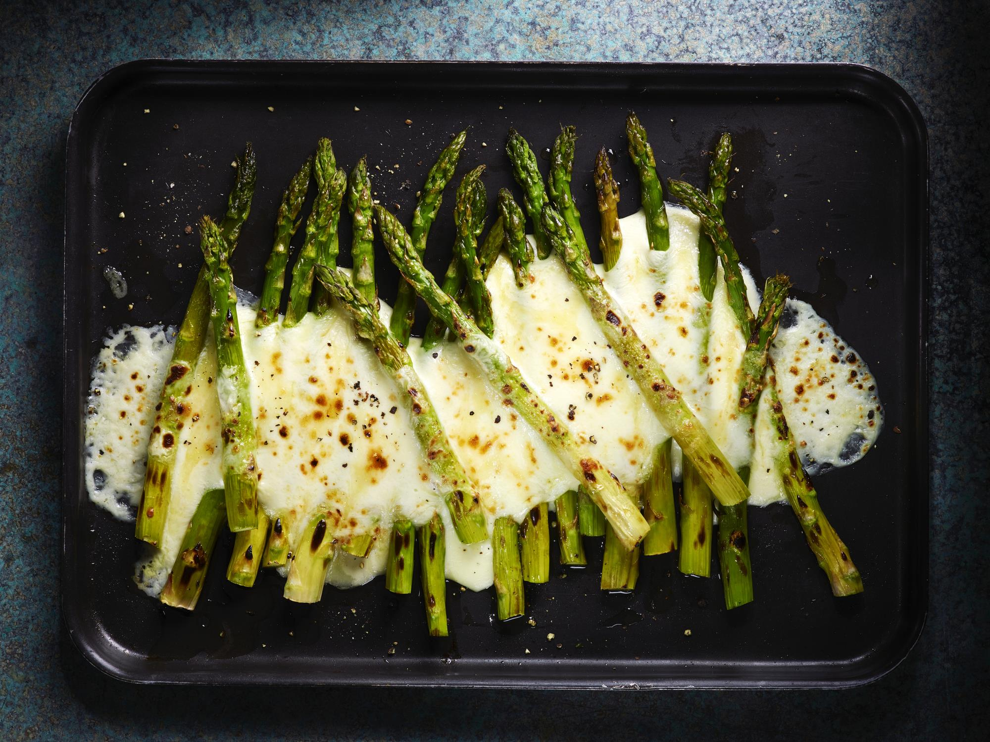 Cheesy asparagus on tray